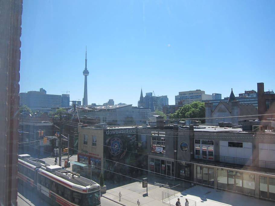 Check out the view from the front window: the CN Tower, Queen West, and a streetcar!