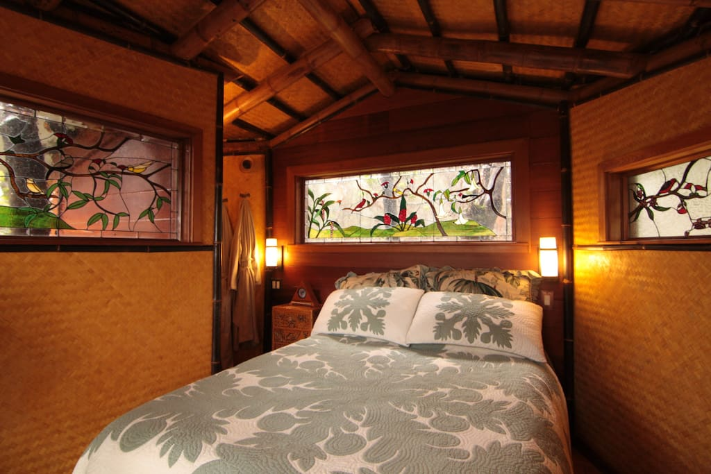 Bedroom with Hawaiian quilt and stained glass