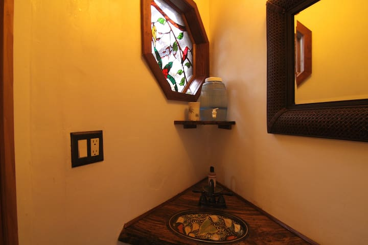 Bathroom sink and stained glass