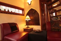 hobbit door, small windows, table lamp chairs
