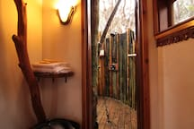 Looking into the outdoor shower from inside the treehouse