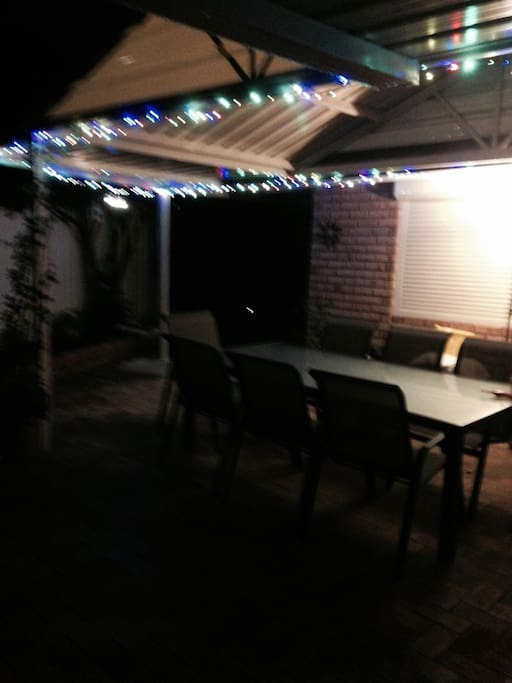 New open spaced patio opens onto back garden that is pleasant to sit out in.