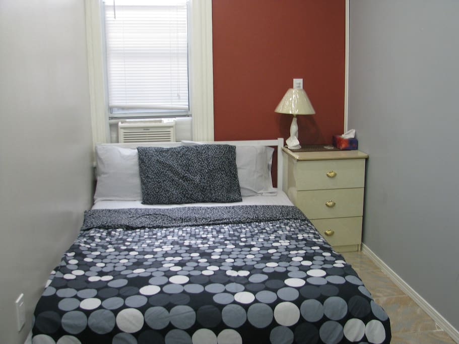 Also included are the bedside table, lamp, and an air conditioner with a remote!