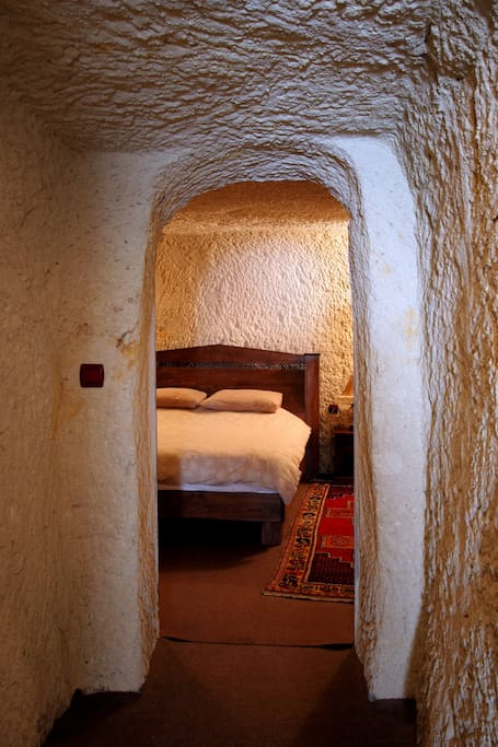Walk through a tunnel from the kitchen/lounge to the bedroom