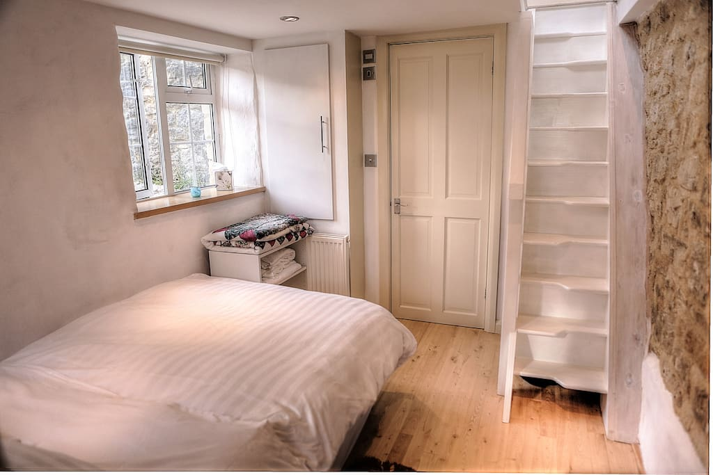 Paddle stairs, right foot first, bedroom with door to shower.