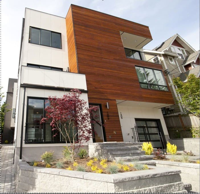 modern town home.  Right most unit with garage and wooden trim.