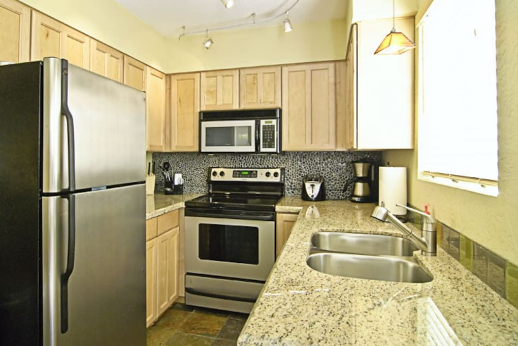 Awesome Kitchen with Stainless Appliances, granite tops, and stone back splashes.