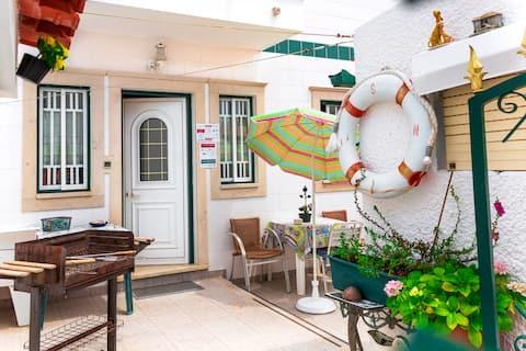 Apartamento con patio y sala de estar - Bela 's Homes