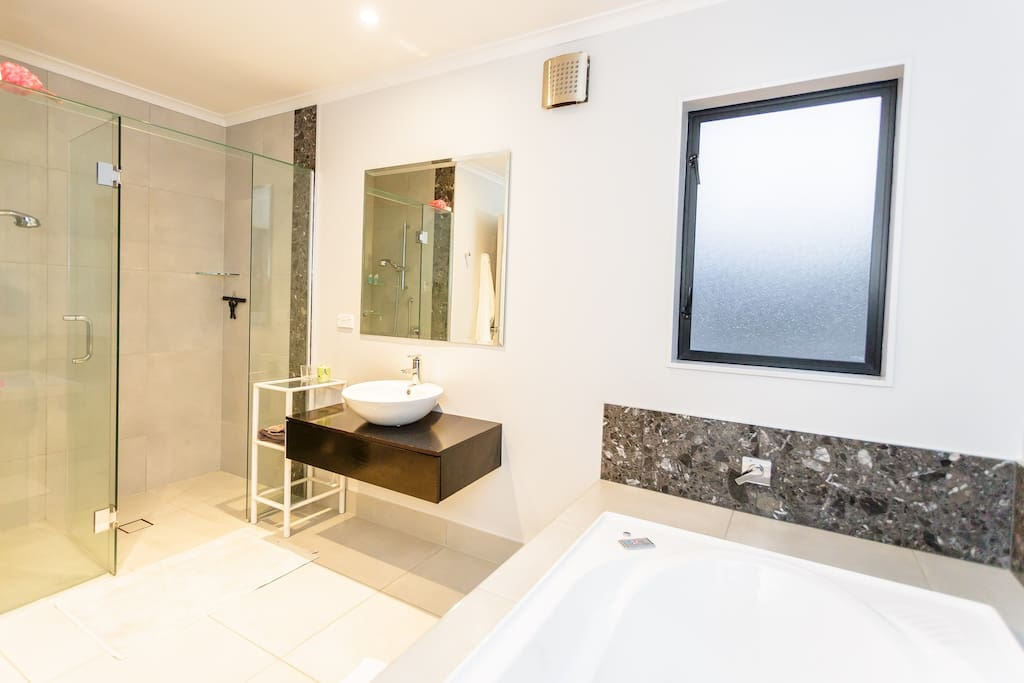 Large bathroom with heated towel rail.  The toilet, with handbasin and mirror, is separate and located next to the bathroom.  There is also a second separate toilet downstairs which is also available for you use.