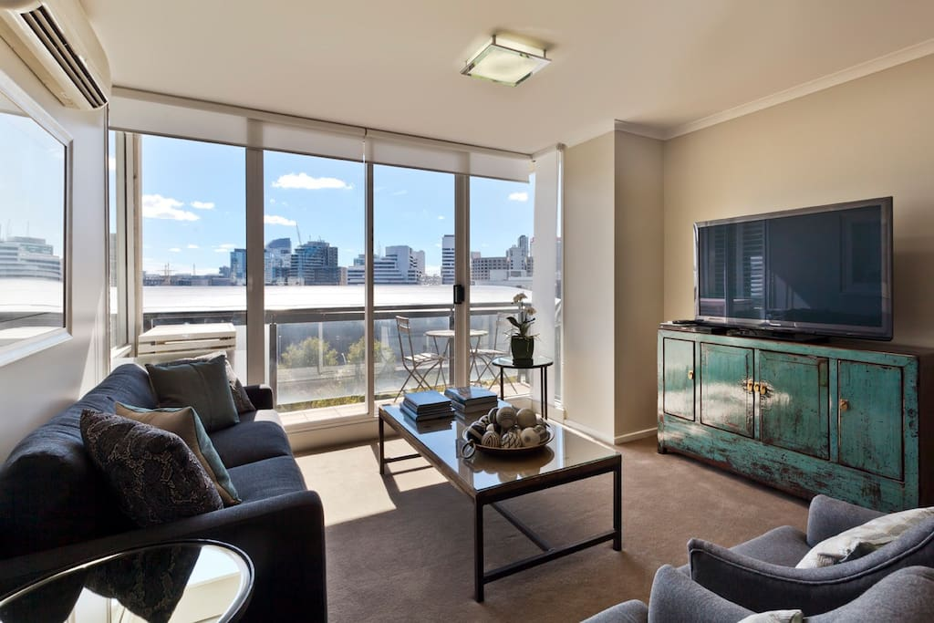 Spacious and stylish living room in this  Cityiside 2 bedroom 2 bathroom StayCentral Serviced Southbank apartment