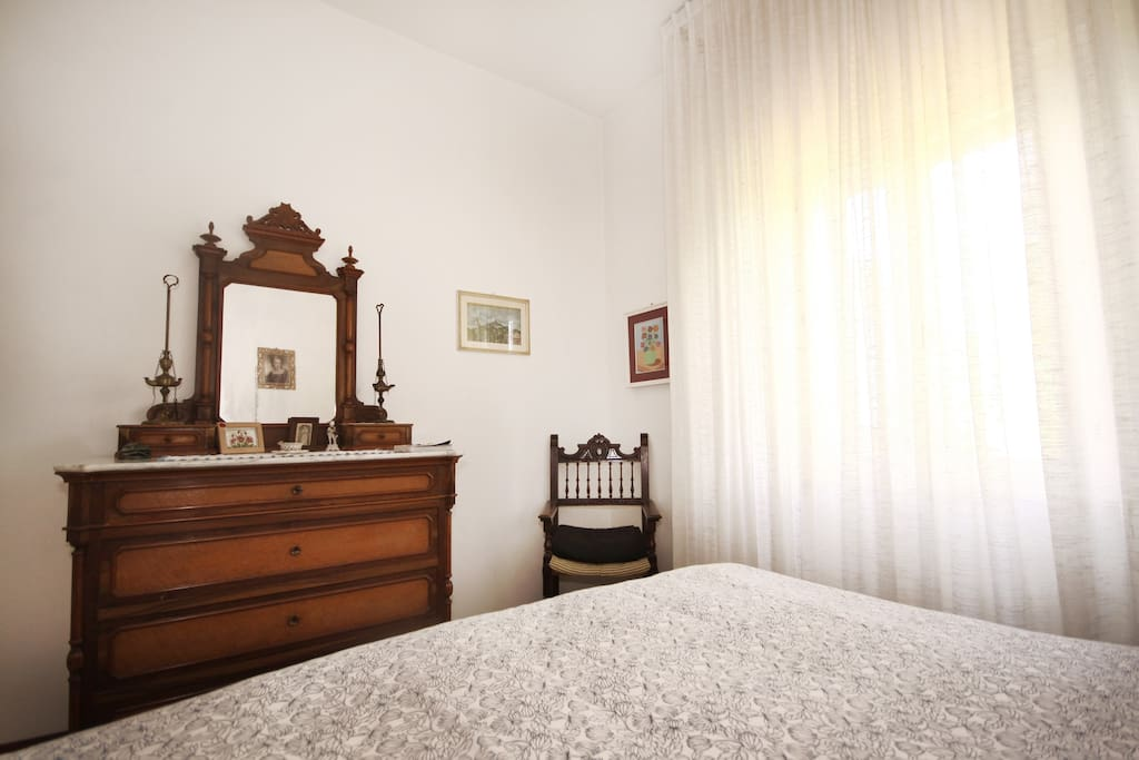 The guest bedroom, with a kingsize bed and original antique furniture.