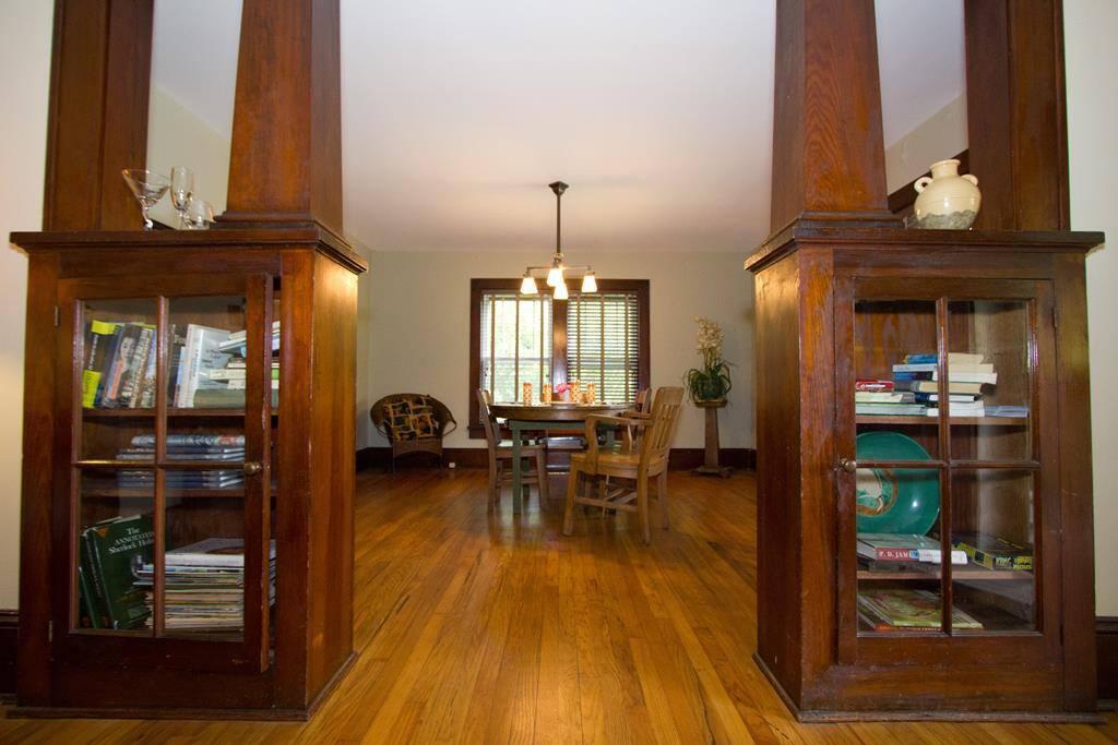 Original hardwood floors and craftsman detailed wood work throughout this cozy cabin