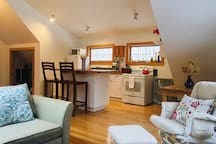 """A warm and beautiful MDI studio. This is a full view from the """"living room"""" space. Couch pulls out to accommodate 2 more guests. (4 total)"""