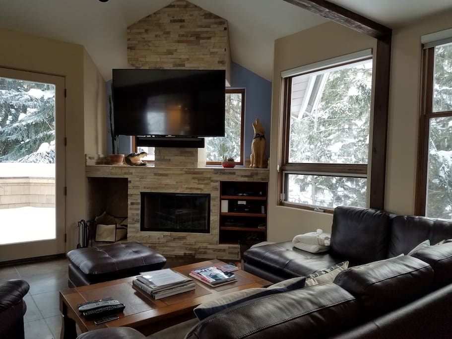 Living room with ski slope views and gas/wood fire place. Large porch with new Webster grill.