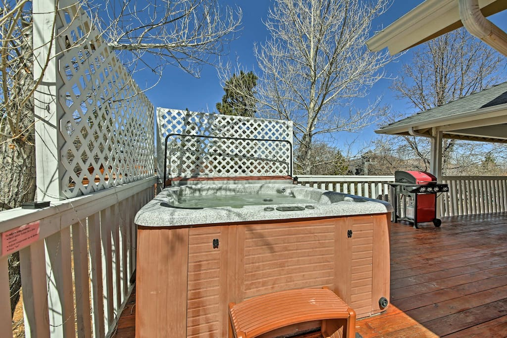 Spend hours on the spacious deck featuring a private hot tub.