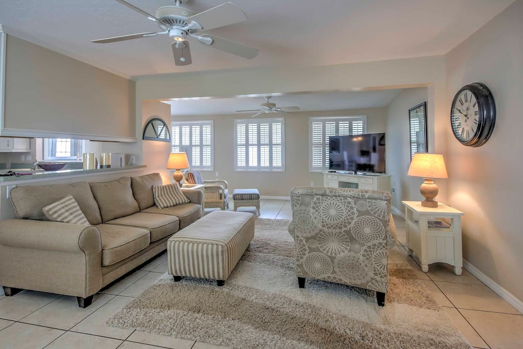 Featuring a comfy plush sofa and armchair, the living room offers plenty of seating.