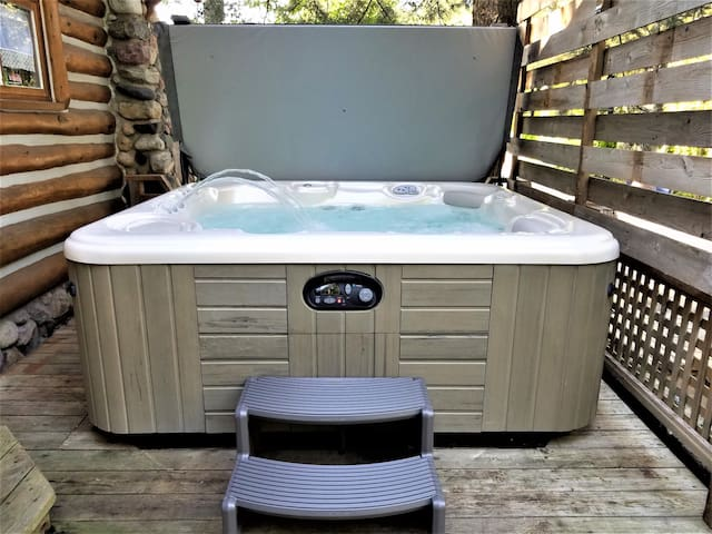 After a long day exploring, step into your private hot tub!
