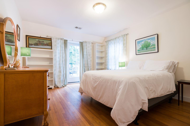 Bedroom has terrace access and en-suite bathroom.