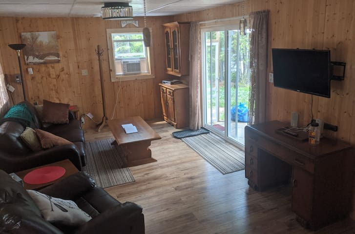 Living room with walkout to porch