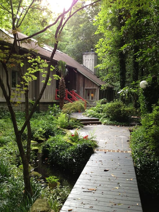 Walkway across the ornamental pond leading to the slate terrace and front entry.