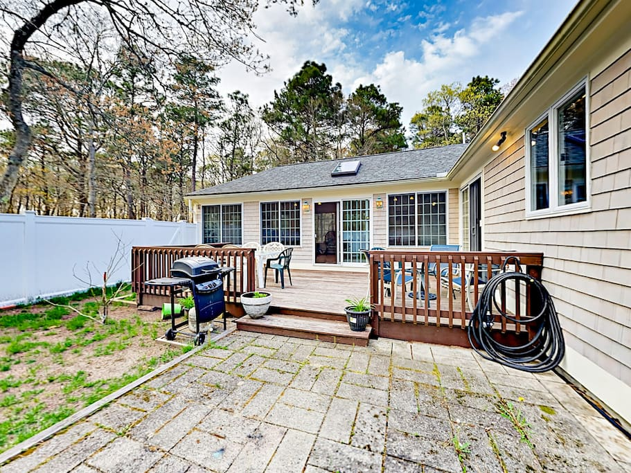 French doors open out to a fenced backyard and deck.