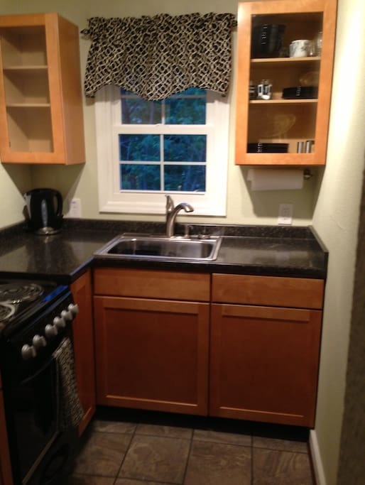 Small but complete kitchen, including coffee maker, microwave, oven, stove and refrigerator