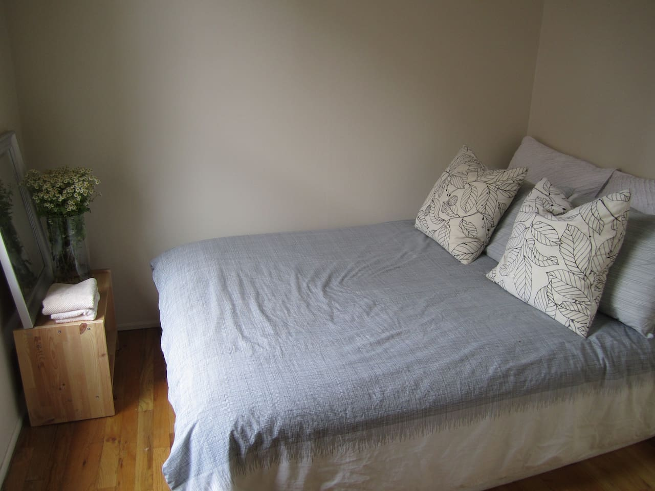 Bright comfortable full size bed in private room overlooking street.