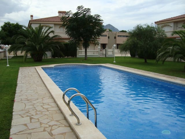 Apartment for four people with large area of gardens and swimming pool