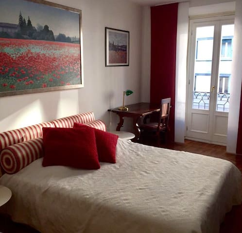 Double bed with very bright day window