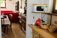 The kitchen is part of the same space as the living room
