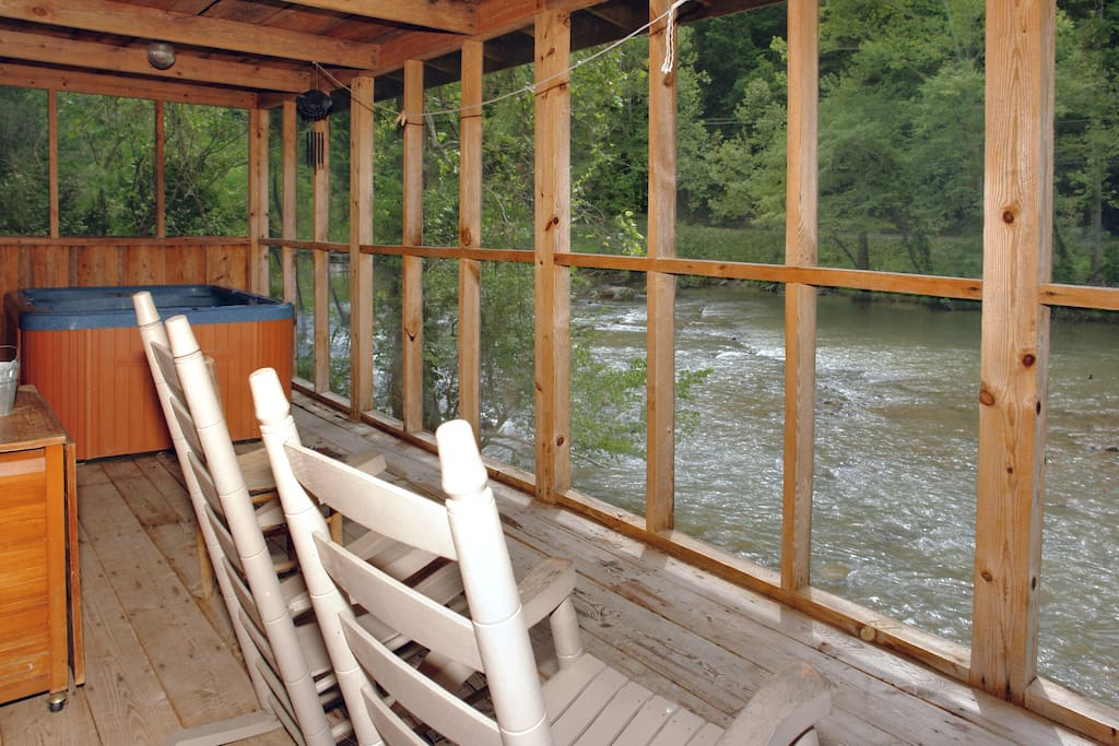 Enclosed back porch with a front-row seat to the Little Pigeon River!