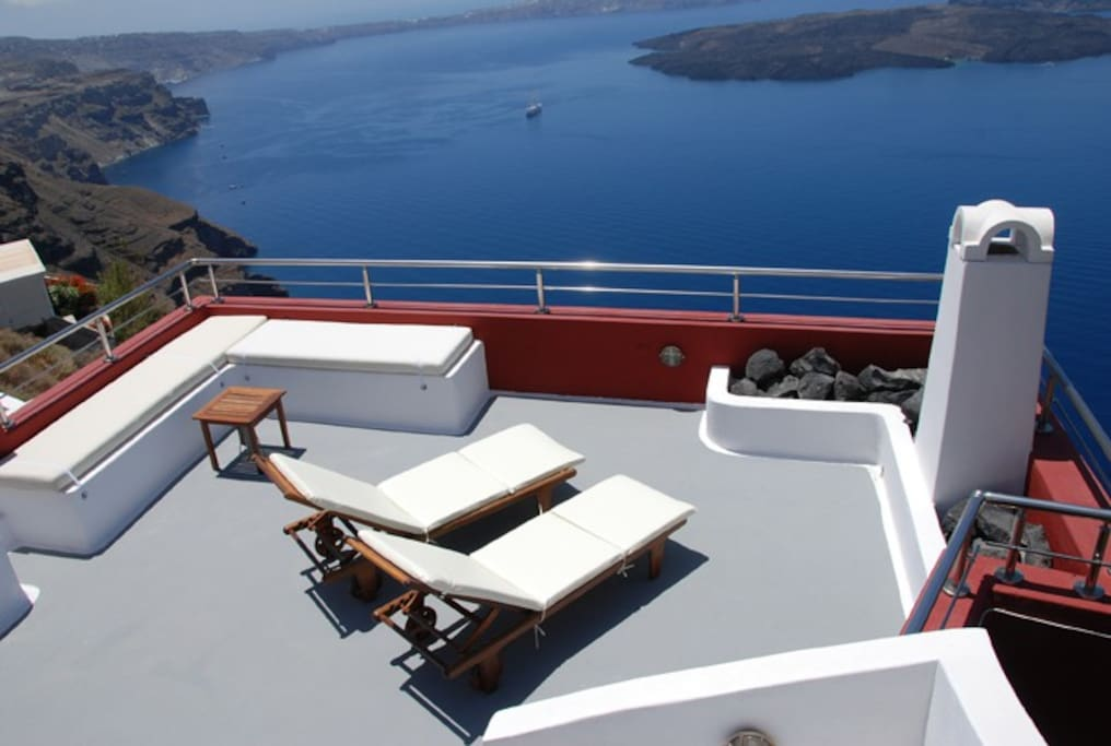 stunning views with sun-beds overlooking the Volcano