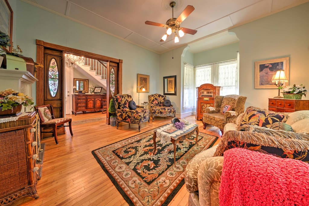 Relax in the living room filled with comfortable furnishings and lovely wood accents.