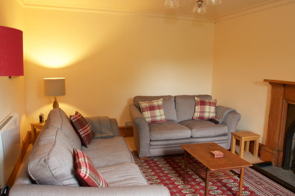 Living room with log burner, TV and  wifi access.