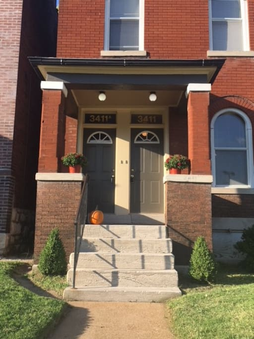 The apartment is on the second floor of this brick two-family.