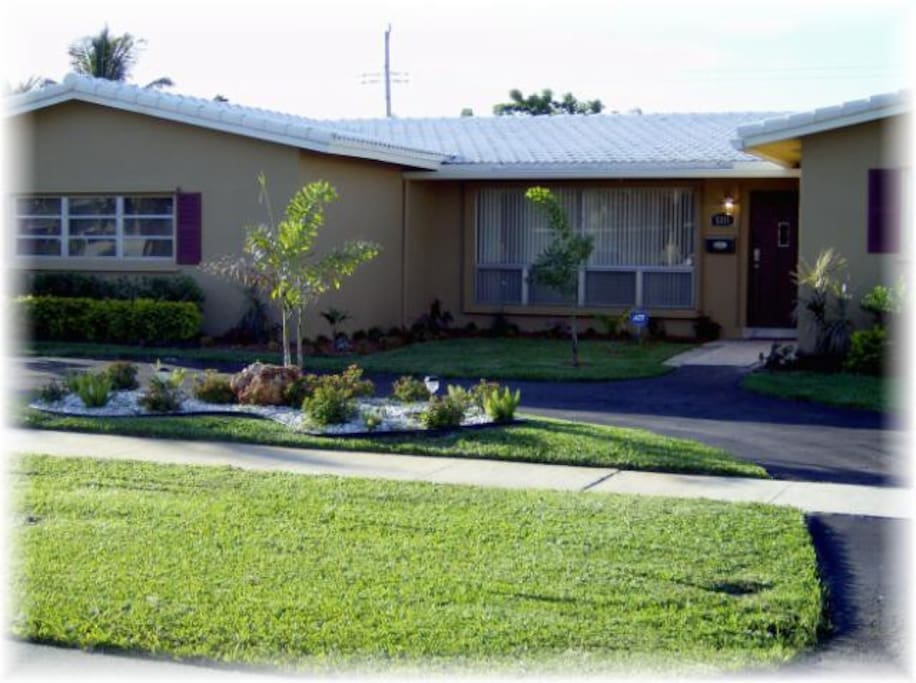 Welcoming Curb Appeal w/Lush Landscaping