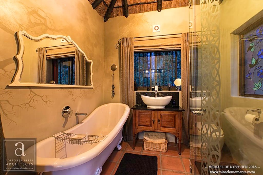 Stone cottage bathroom with shower and bath