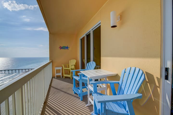 Beachy, waterfront getaway w/ a furnished balcony, shared pools, & gym