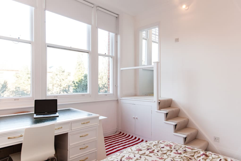Such a bright and peaceful apartment with wonderful views over a private garden