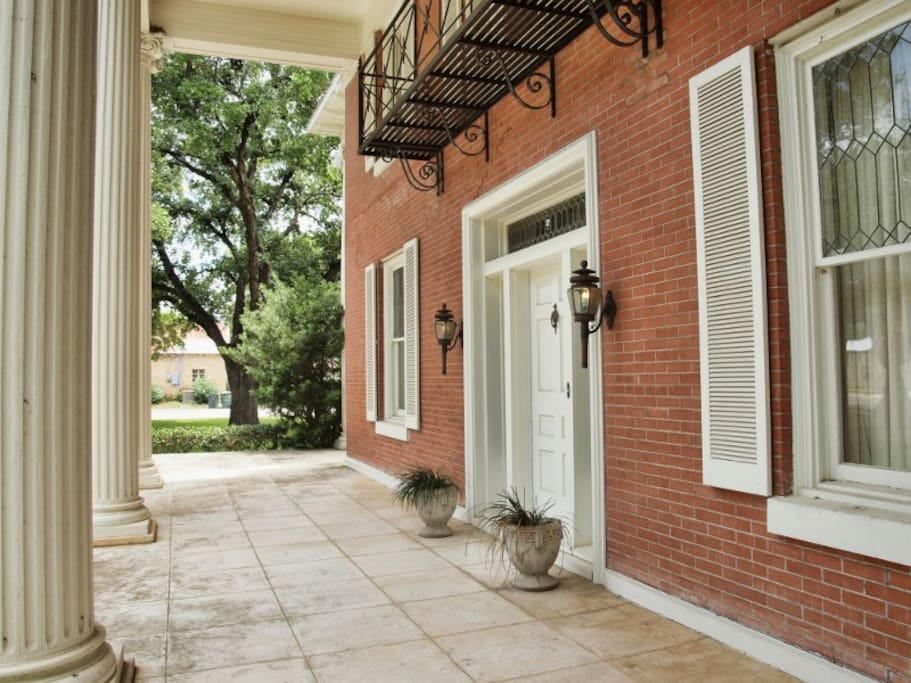 Grand front porch with historic while columns