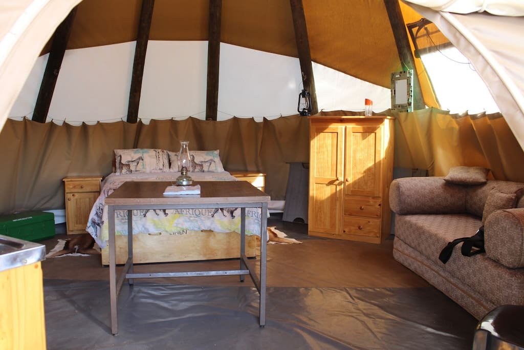 Double bed and double sleeper couch in Tipi