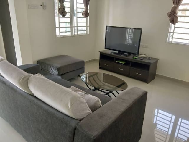 Living room with aircon Big Tv with astro  Comfy L shape sofa with pillows