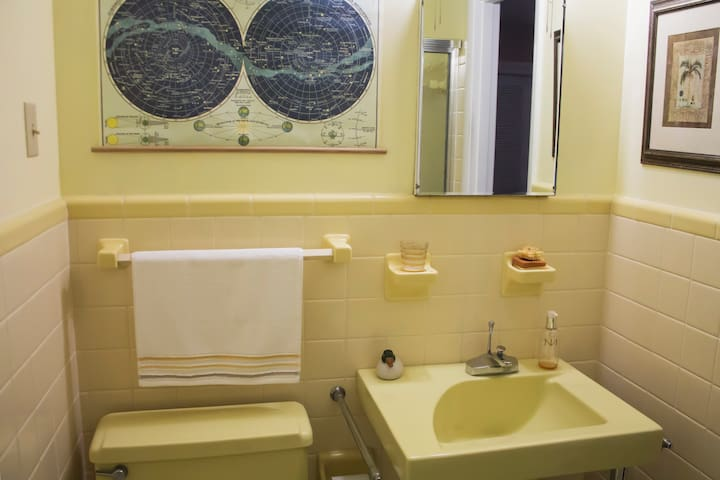 Sunny retro private bathroom connected to your cozy quarters.
