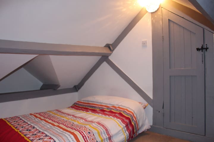 Bedroom 1 with double Queen  bed and skylight window