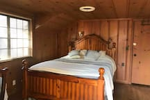 Private large master bedroom in a cabin style home