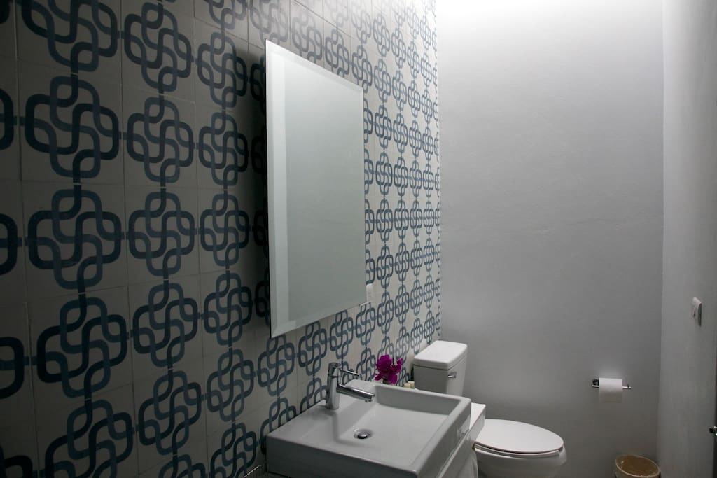 Private bathroom with unique artisanal Oaxacan tiles.