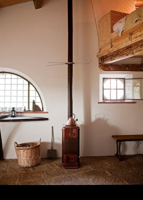 A charming old wood stove will warm you up , if you should decide to visit us in the fall...