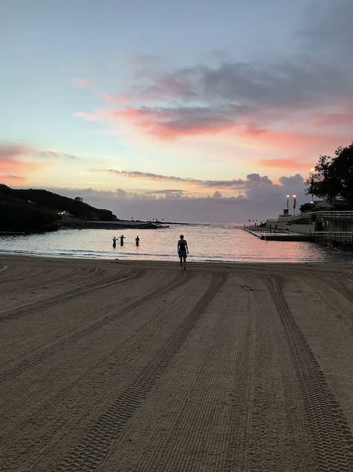 Sunrise and swimmers at Clovelly Beach
