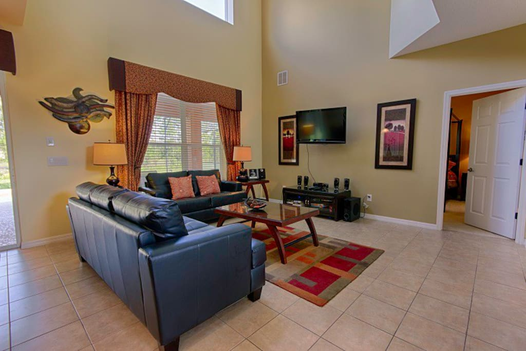 Family room with large TV, cable TV, DVD player.