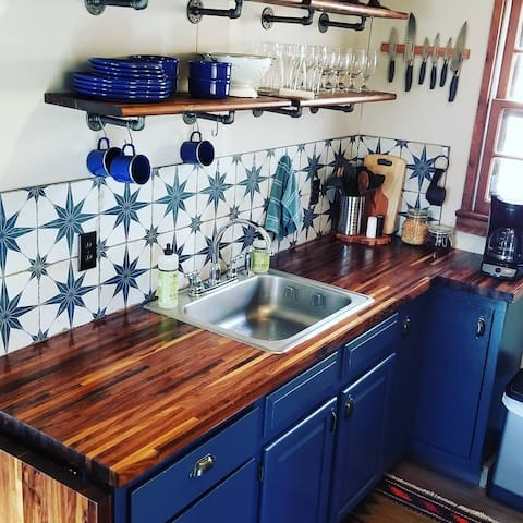 New walnut countertops and rustic tile backsplash